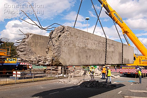 A110 00080 Mobile Crane Lifting A Section Of Demolished