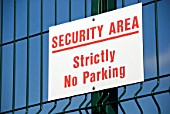 Security area sign on fence