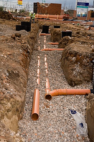 A134 00027 Plastic Sewage Pipes Laid In A Trench Filled