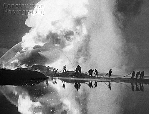 Firemen putting out a burning oil gusher Makhachkala Republic of Dagestan Russia August 1977