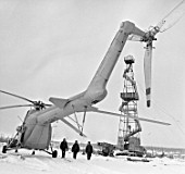 Helicopter delivers new shift to oil rig, Sakhalin, Russia, 1972