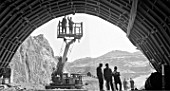 Construction workers assemble roof of drainage tunnel at Kapchagai hydropower plant, Kazakhstan, USSR, 1969