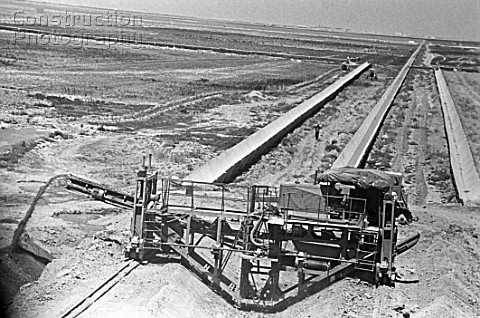 Construction machines laying an irrigation canal in the Golodnaya steppe Uzbekistan USSR 1977