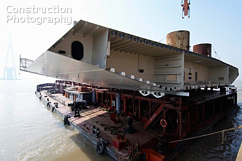 Steel box girder deck unit prior to being lifted into position at Sutong Bridge in Jiangsu Province