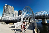 Steel Webb footbridge in Docklands district of Melbourne, Australia; Designer Denton Corker Marshall