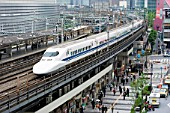 Bullet train travelling over elevated section of track in central Tokyo 2008