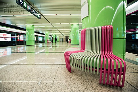 Detail of new subway station platform architecture with green finishes and modern seating at Beixinq