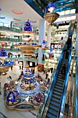Interior of modern new Joy City shopping mall in Xidan district of Beijing 2009
