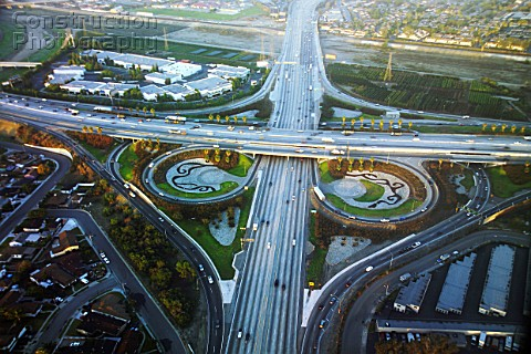 The 605  10 Freeway interchange Los Angeles California USA aerial view dawn