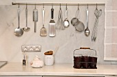 View of kitchen tools hanging on wall