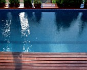 View of a wooden deck beside a swimming pool