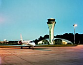 The tower of Farnborough airport with parked airoplane. Designed by 3d reid architects.