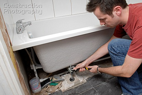 A160 00094 man installing new bath construction photography for New bathroom installation