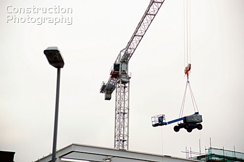 Tower crane lifting smaller crane