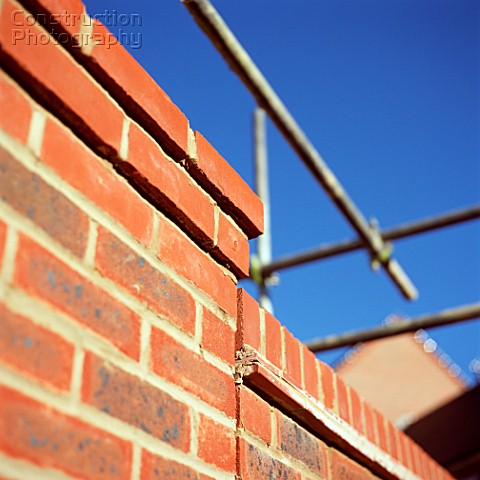 Scaffolding on brick wall