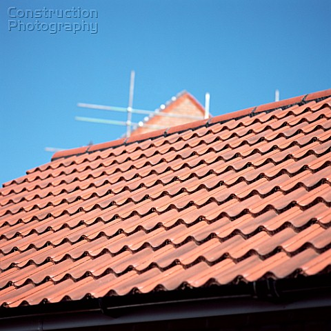 Tiled roof and scaffolding
