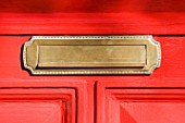 Letter box in red door