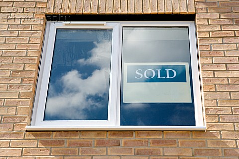 Sold sign in modern window