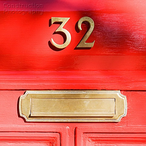 A162 03460 Letter Box And Number On Red Door Construction Photography