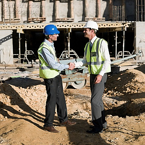 Mature men meeting on construction site. Asset Information : A162-03797