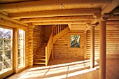 Interior of log cabin and staircase. Isle of Anglesey, North West Wales.