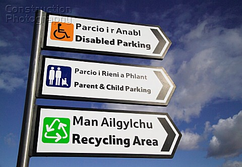 Bilingual signs Welsh and English car park Bangor North West Wales UK