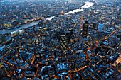 Aerial view of City of London over River Thames at night, London