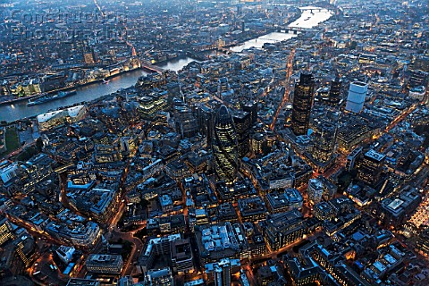 Aerial view of City of London over River Thames at night London