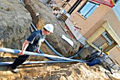 Construction workers installing underground electrical conduit Warlyn Construction, residential  Ottawa Ontario Canada
