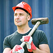 Builder with sledge hammer