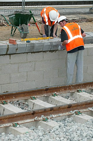 R001-00406: New platform coping stones being placed into