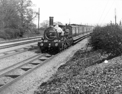 GWR Broad Gauge Rover Class believed to be Great Western on a down express near Acton C1890